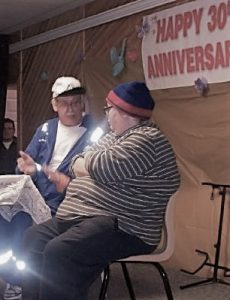 A man and a woman speak their part in a Mother's Day concert