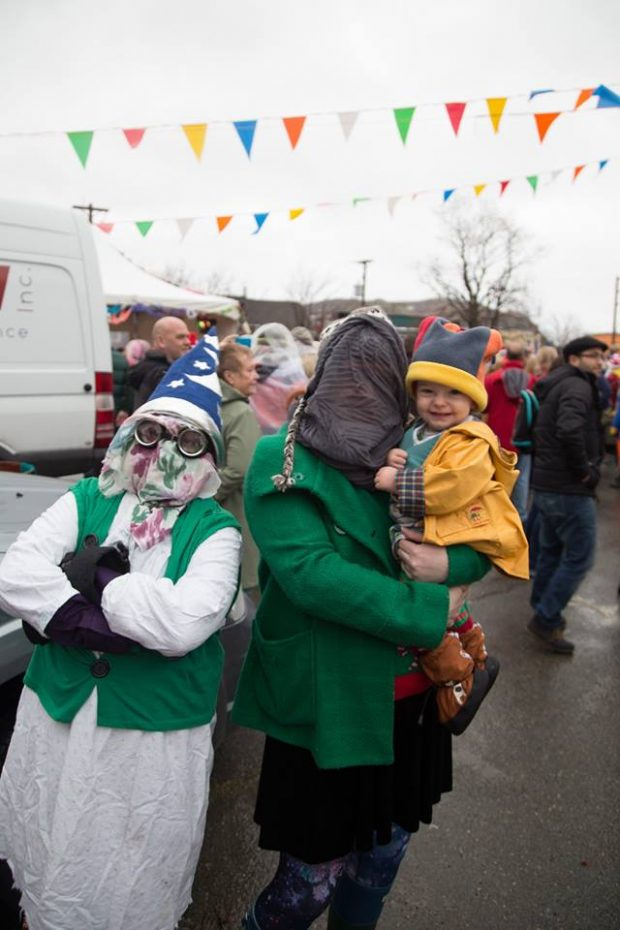 Two Mummers and a child on Parade