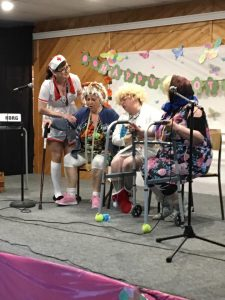 A group of women on stage doing a skit