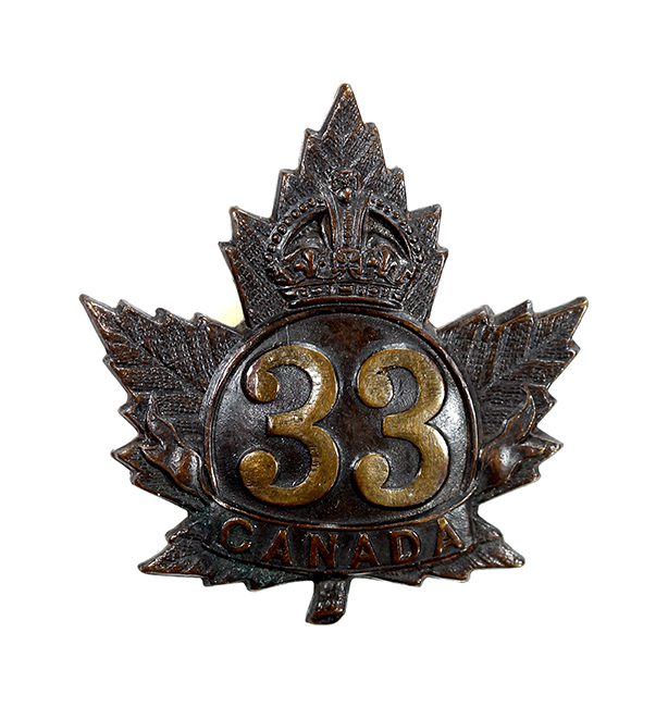 A badge in the shape of a maple leaf with a crown, number 33 and Canada.
