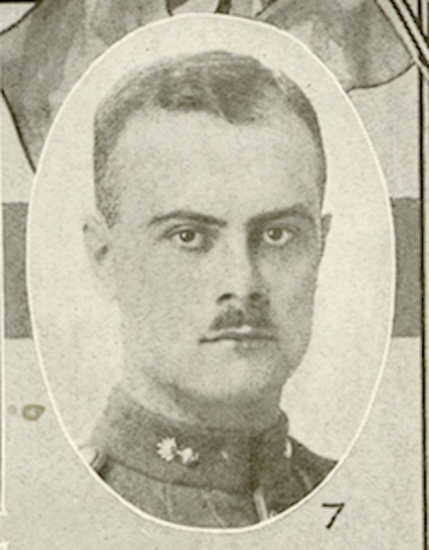 Portrait of a soldier with a moustache.