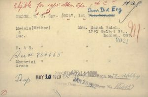"""A card typed with handwriting in red and blue ink. The card is dated """"May 20 1920"""" and """"Jan 28 1922""""."""