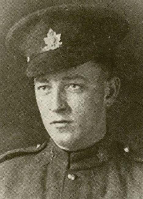 Portrait of a soldier wearing peak hat.