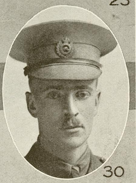 Portrait of a soldier wearing a peak hat. He has a moustache.