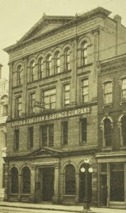 """A photograph showing a 4 storey building with the following sign: """"Huron & Erie Loan & Savings Company."""""""