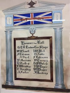 """A Roll of Honour including 16 names in a rectangular shape. The shape is surrounded by elaborate neoclassical decorative architecture with a union jack flag superimposed by the inscription """"To the Fallen."""""""