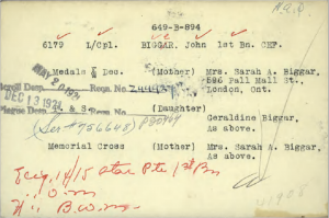 A card typed with next-of-kin information for Lance Corporal John Bigger. Stamps showing dates and red handwriting can be seen.