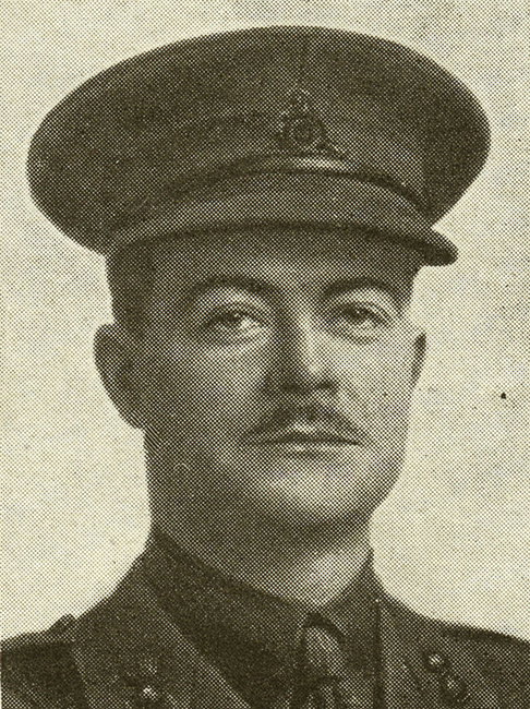 Portrait of a soldier wearing peak hat. He has a moustache.