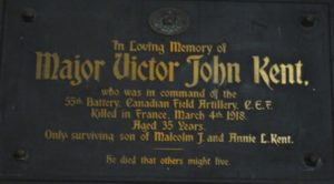 A plaque featuring writings in brass letters, dedicated to Major Victor John Kent.