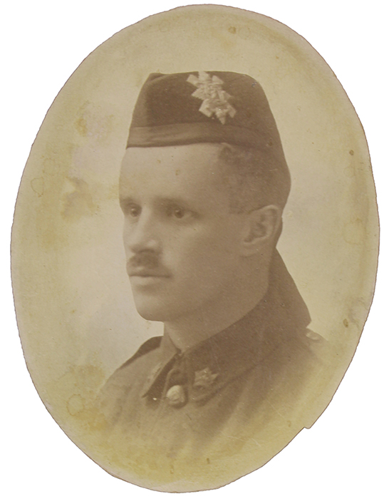 Portrait of a soldier with a moustache. he wears a wedge hat with badge and ribbons at the back (Highlander)