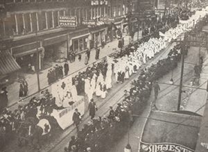 Black and white photograph showing a parade of nurses.