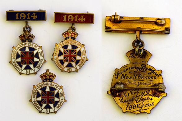 3 small pins shown on obverse of enameled metal and 1 larger pin shown on reverse, with writings. 2 of the smaller pins show the year 1914.