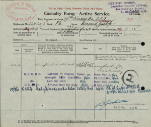 "A form completed in handwriting. Many stamps in red and purple ink. The title of the form is ""Casualty Form - Active Service."""