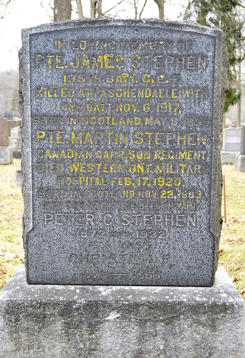 A grave stone with writings carved in.