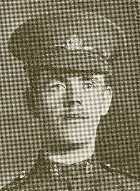 Portrait of a soldier wearing a peak hat. He has a moustache.