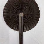 A black circular fan.
