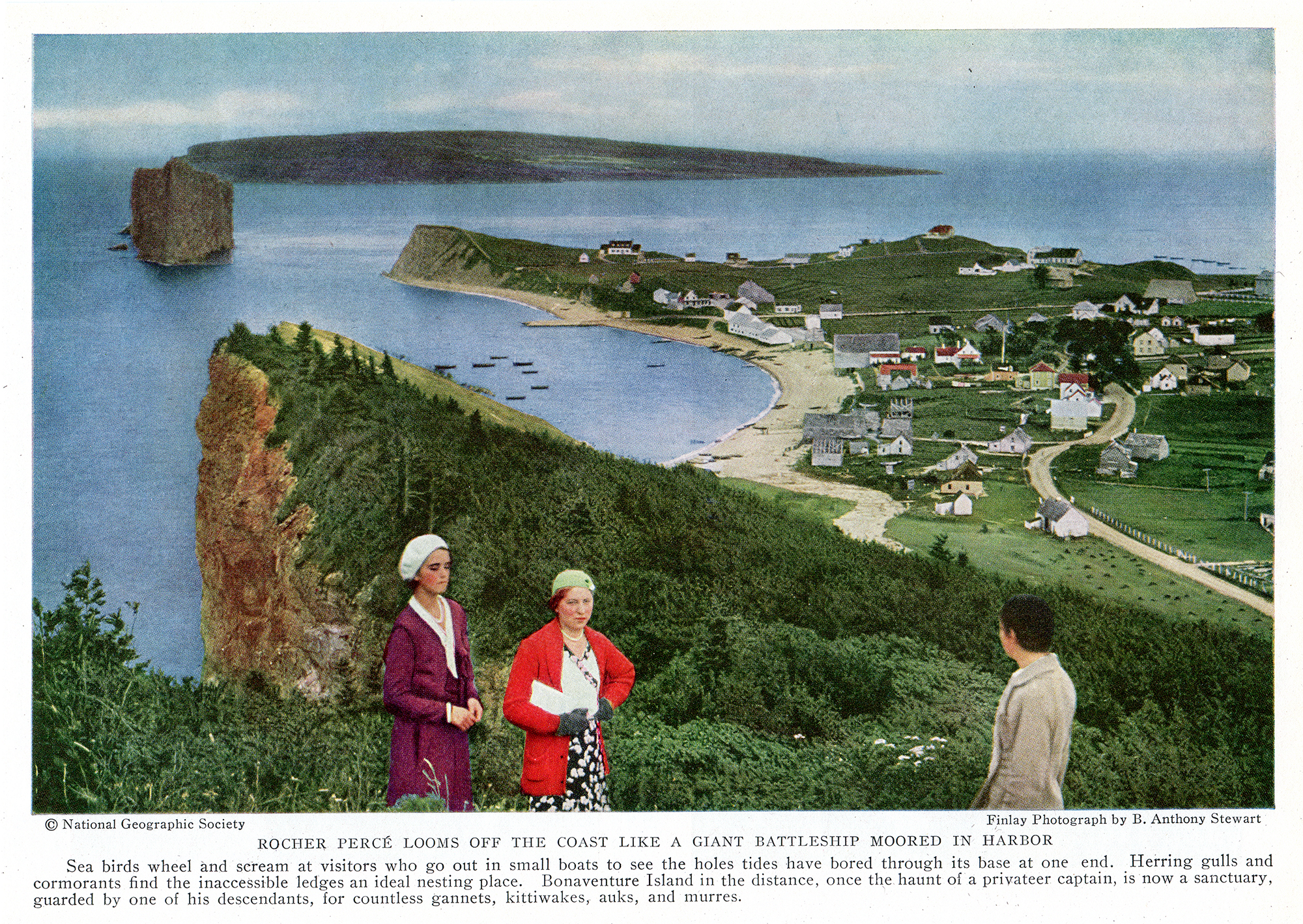 The photograph was taken from a point of view that allows us to see the village of Percé in the 1930s and the dirt road leading to it. There are some boats near the shoreline and in the distance the Percé Rock and Bonaventure Island. In the foreground, two women look in our direction and a third person admires the landscape.