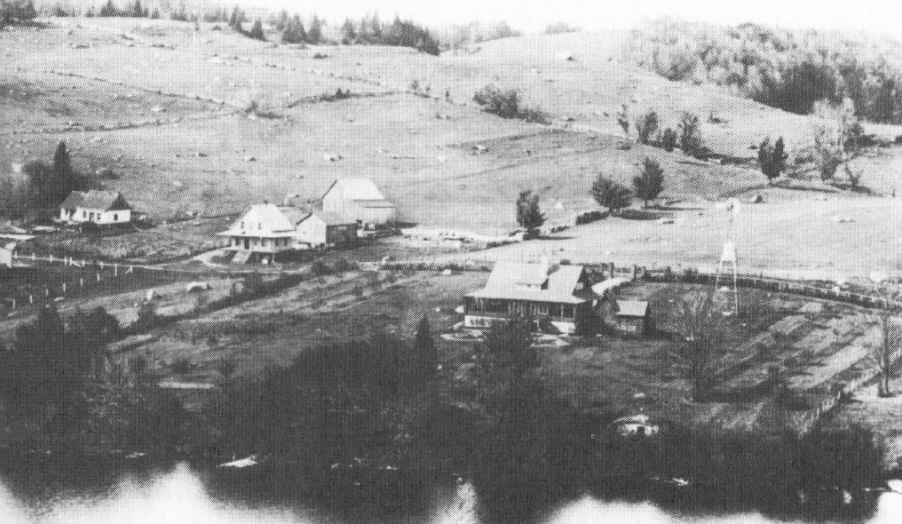 Old aerial photo of the Lac Paquin region showing several houses and a noticeable absence of trees.