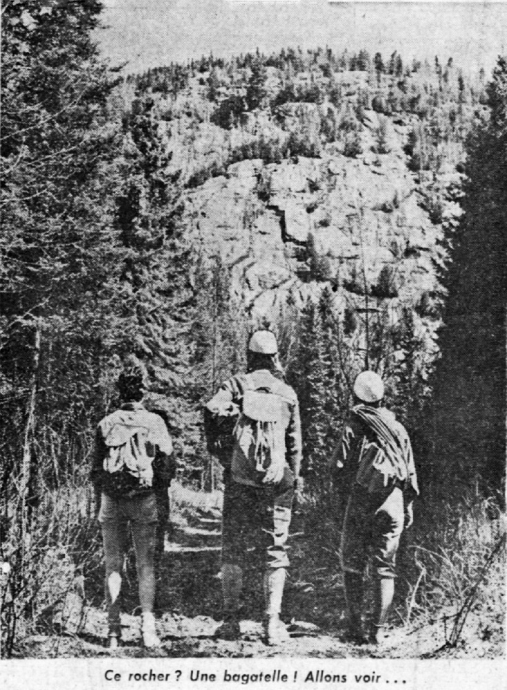 Three climbers in the forest with their equipment, looking towards Mont Césaire.