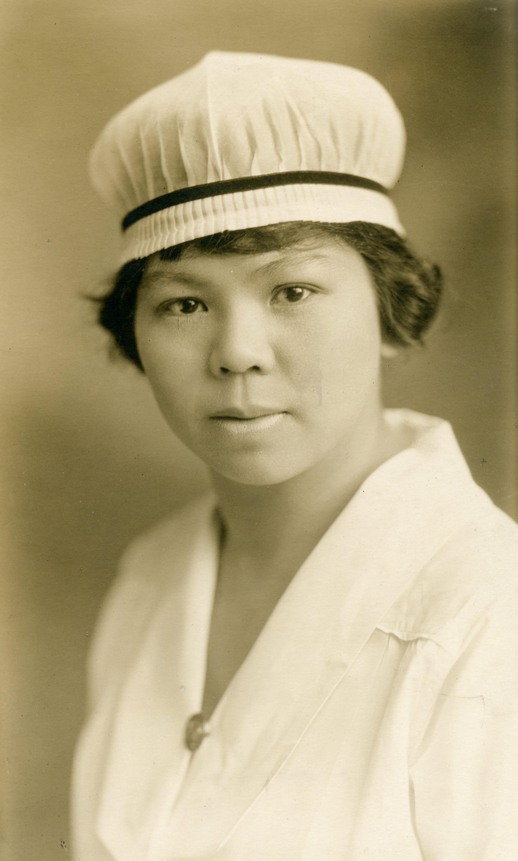 Formal portrait of young lady in full nurses' uniform.