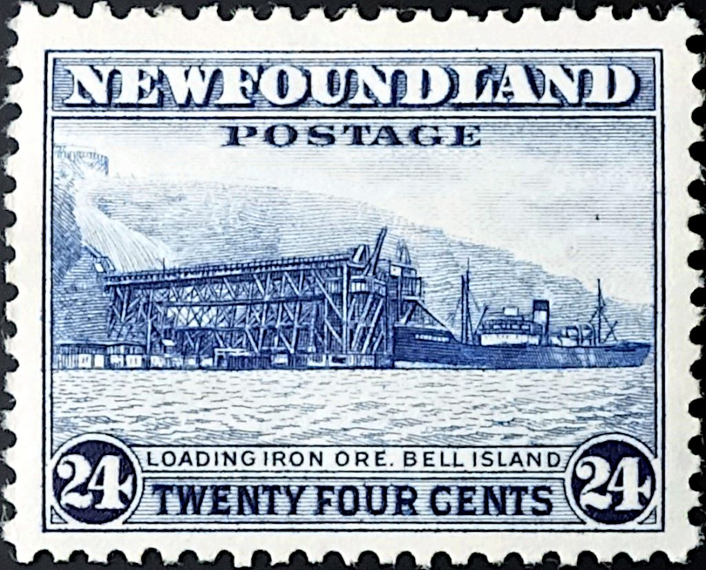 Newfoundland postage stamp showing a ship loading iron ore at Bell Island loading pier