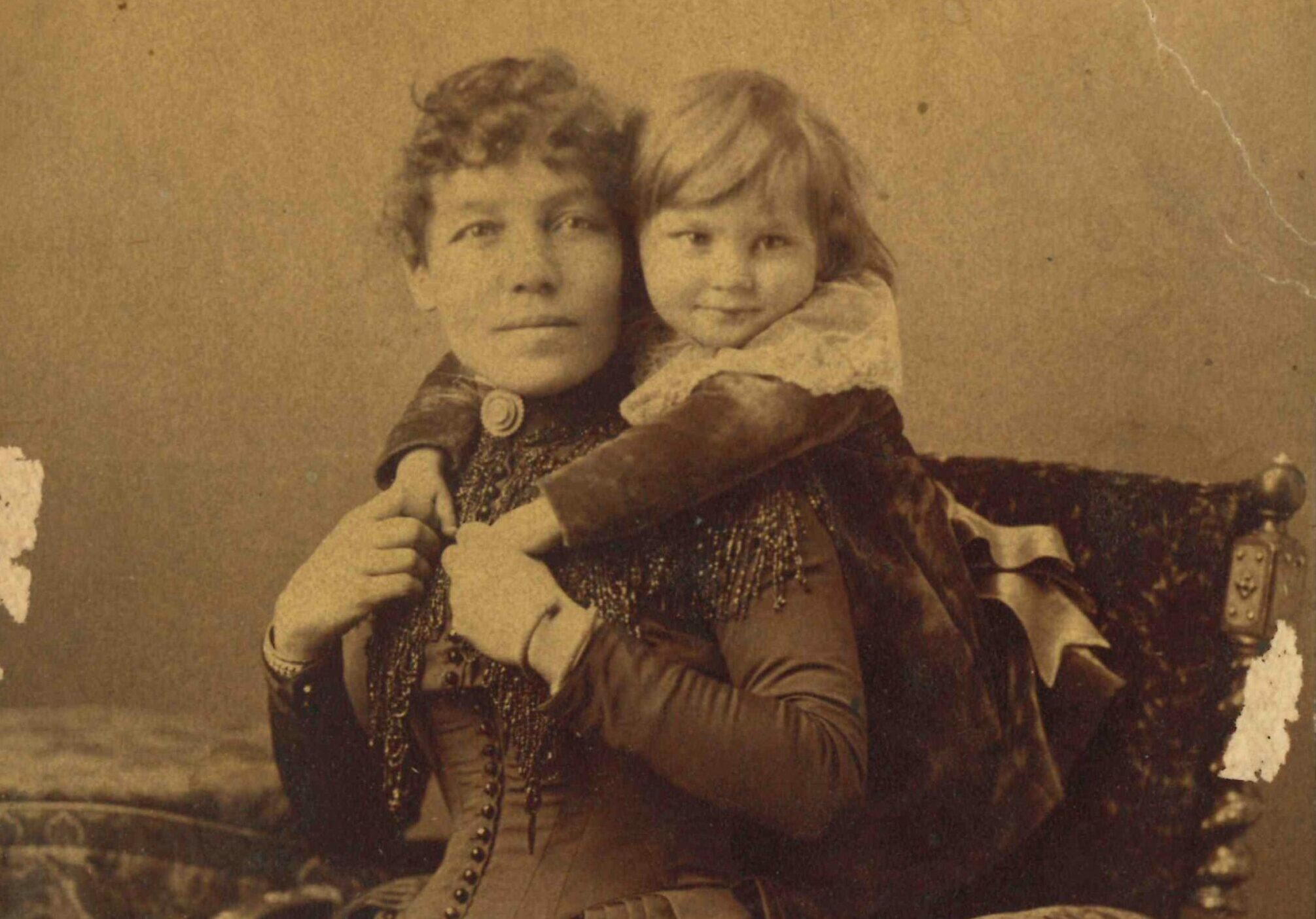 Photo of Isabella Lougheed with their eldest son, Clarence, at approximately 2 years old, c.1887.