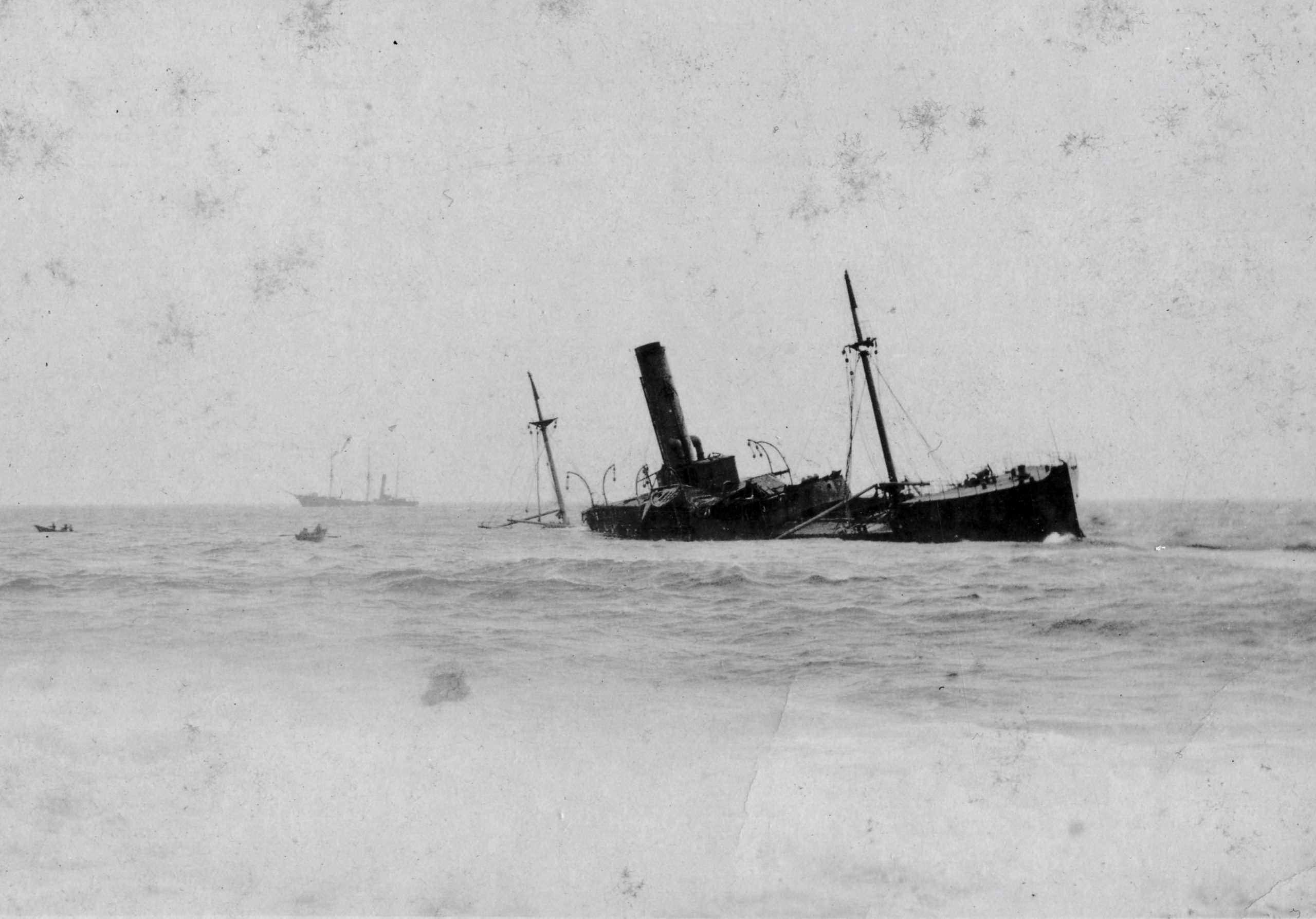 Black and white archival photograph of large passenger liner ship, the SS Florizel, run aground in ocean.