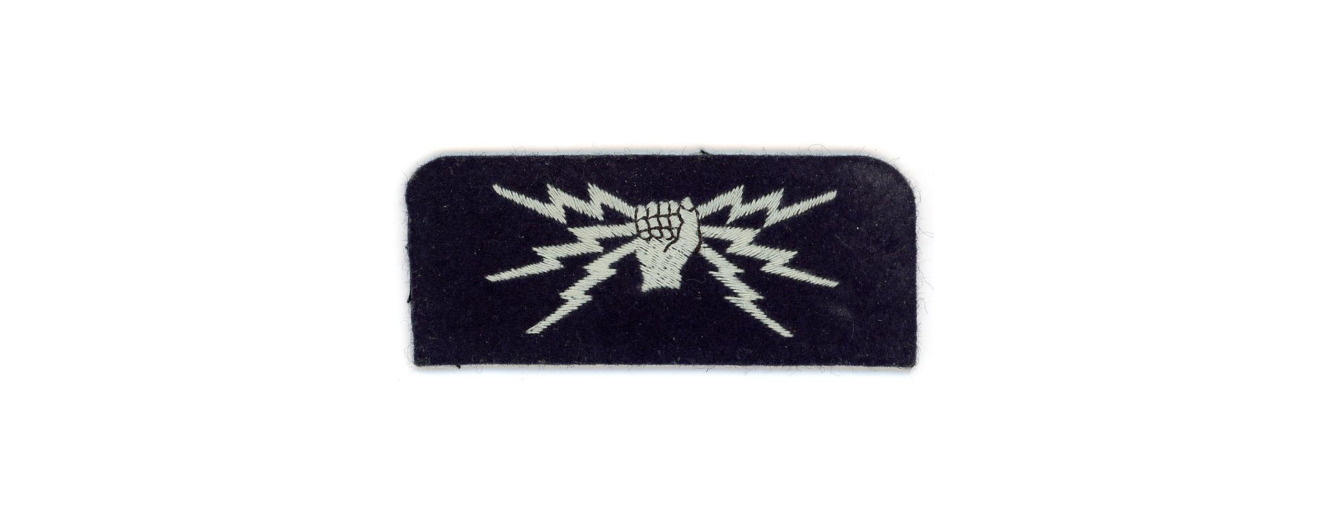 A dark blue felt patch with embroidered white fist holding 3 lightning bolts