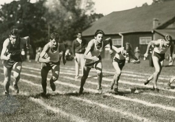 Jack Cox, Glen Dix, and Dudley Wilcox among others are pictured at the start of a footrace in the 1930s.